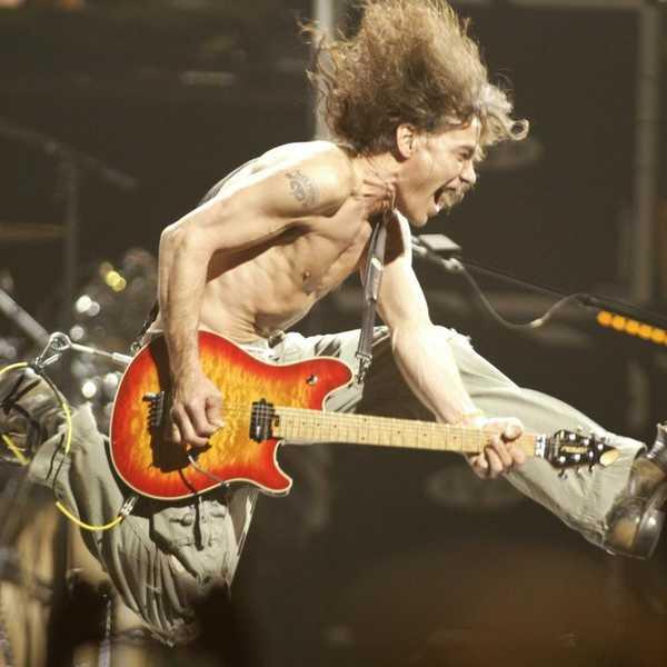 "Eddie Van Halen plays the final chord of ""Jump"" during a Van Halen concert in 2004. Picture: AP Photo/The Star Ledger, John Munson"