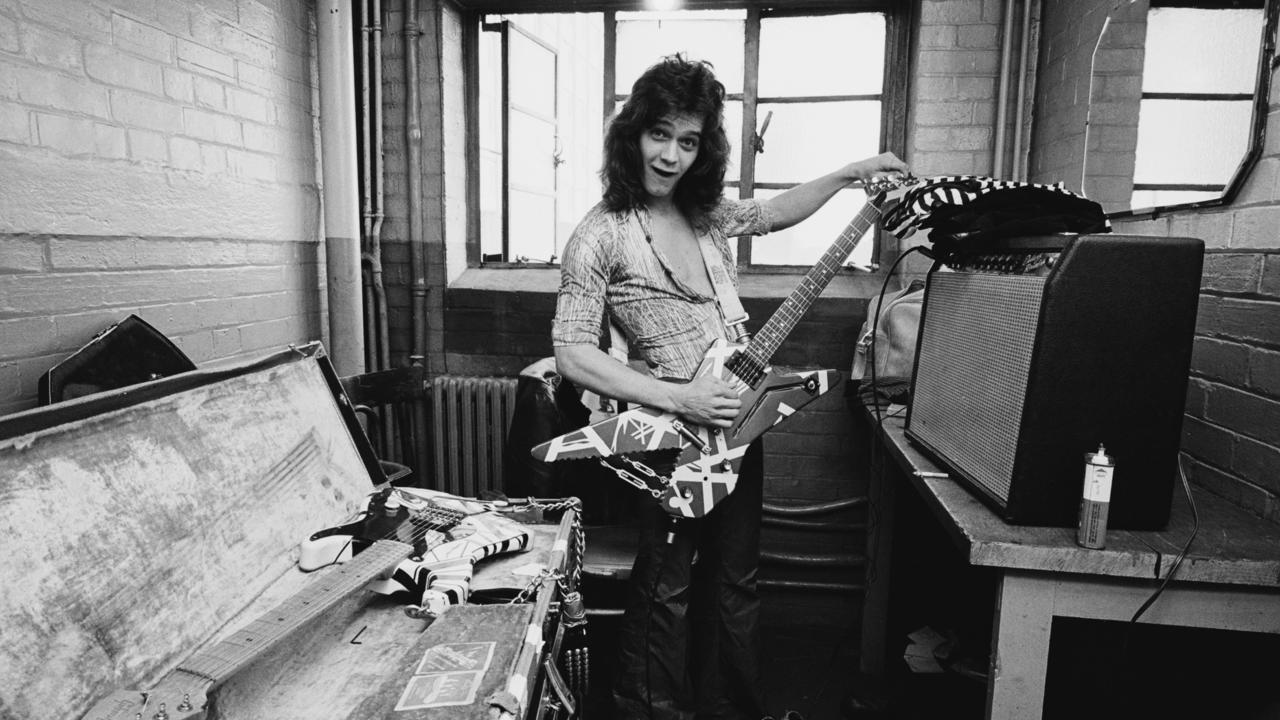 Eddie Van Halen from Van Halen poses backstage at Lewisham Odeon in London on 27th May 1978. (Photo by Fin Costello/Redferns)