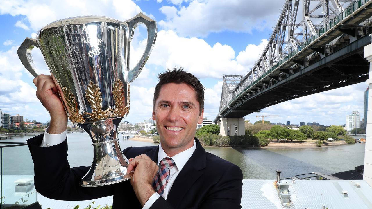 AFL Ambassador Simon Black with the AFL Premiership Cup alongside the Story Bridge in Brisbane. Photographer: Liam Kidston.