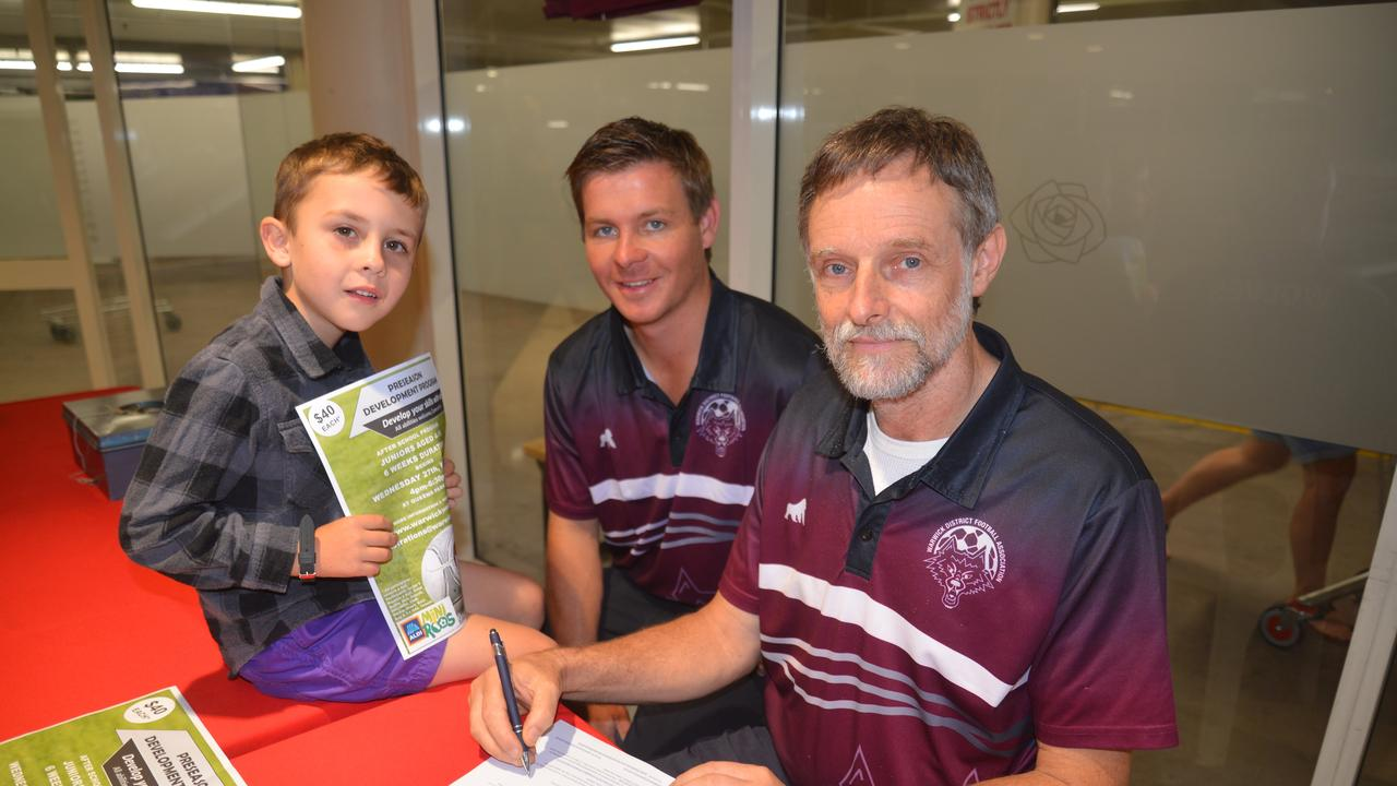 Warwick Wolves junior Khale Lockley with officials Cameron Davey and Peter Darton at a football information day. Picture: Gerard Walsh