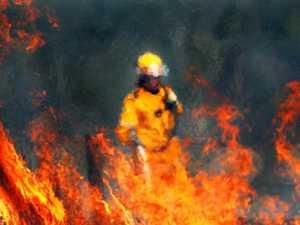 Fireys monitor large grass fire at Lower Wonga