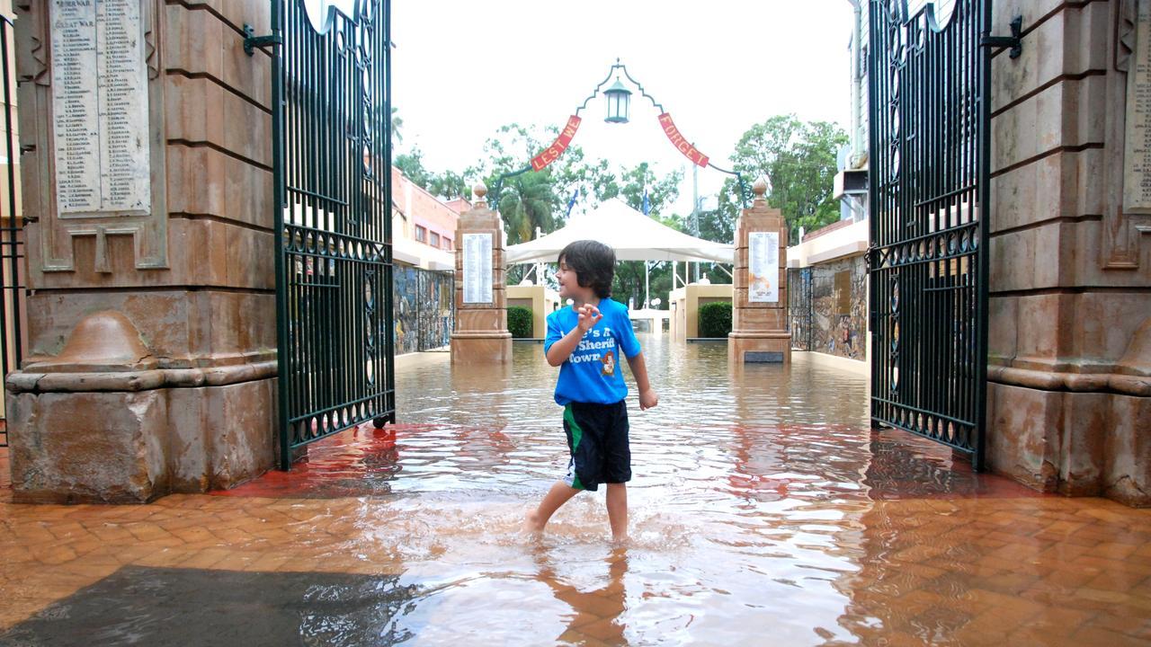 Kaydin Vonschoeler in the first flood water to enter through the Memorial Gates, 2011. Craig Warhurst The Gympie Times