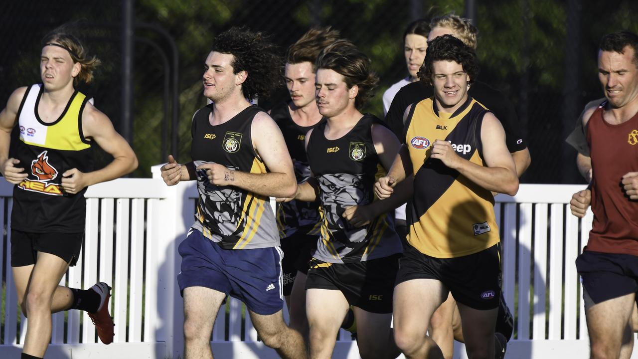 COUNTDOWN BEGINS: Grafton Tigers' players going through their paces on Tuesday night in preparation for their North Coast AFL grand final appearance on Saturday. Photo Gary Nichols