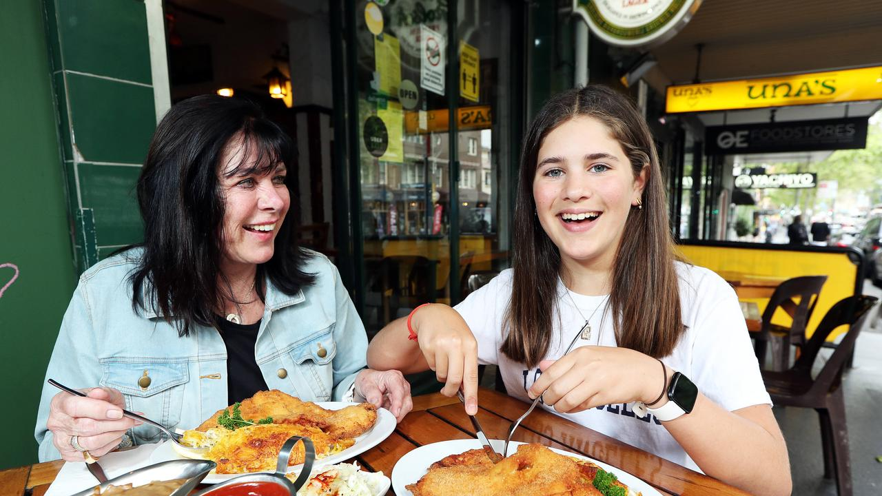 Poppy Senes 12, with her grandma Inge Senes at Una's in Darlinghurst which has been awarded NSW best schnitzel by Wotif. Picture: Tim Hunter.