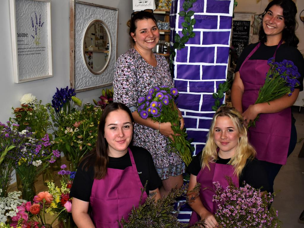 The staff at Paper Daisy Florist in Prince St are busy making preparations to dress their shopfront purple for the jacaranda season.