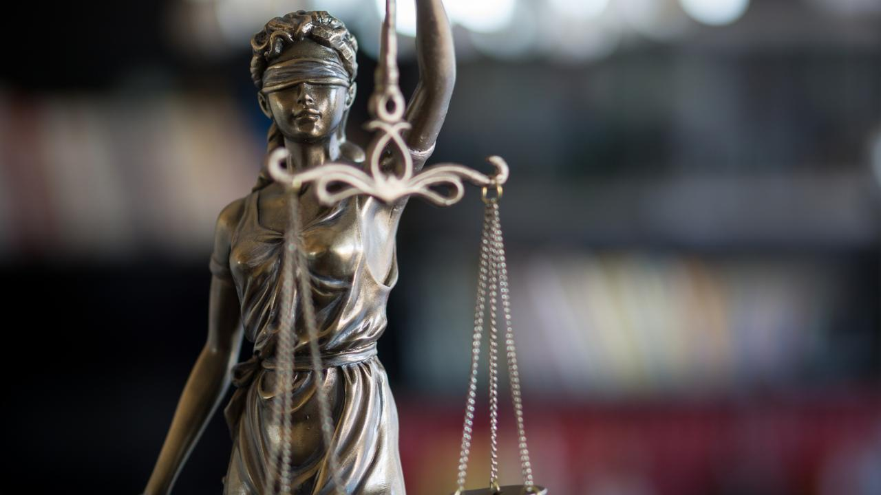 Statue of Justice with scales in lawyer office. Legal law, advice and justice concept.
