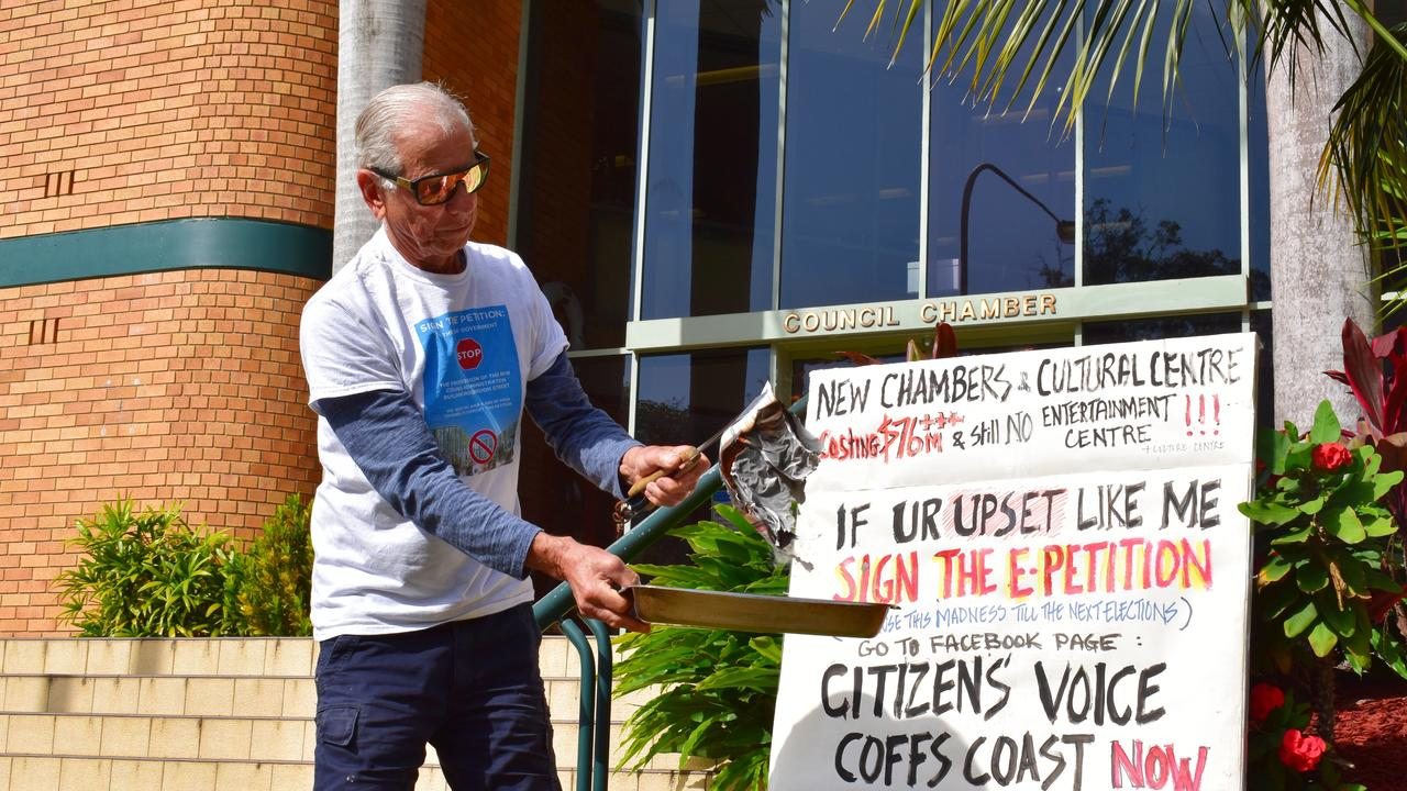 George Partos burning his rates notice outside Coffs Harbour City Council chambers on September 28. He held another protest outside chambers this afternoon.