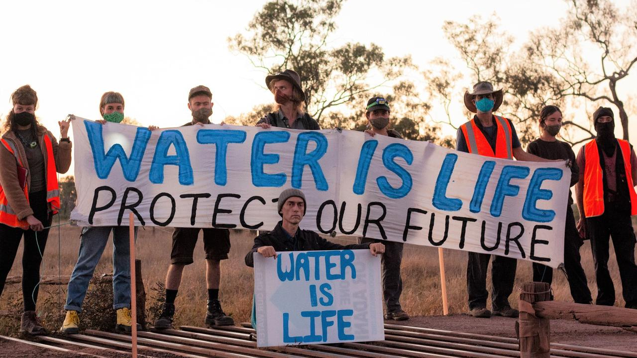 An environmental activist has disrupted work on Adani's Carmichael rail corridor October 8 near the Suttor River. Photo: contributed