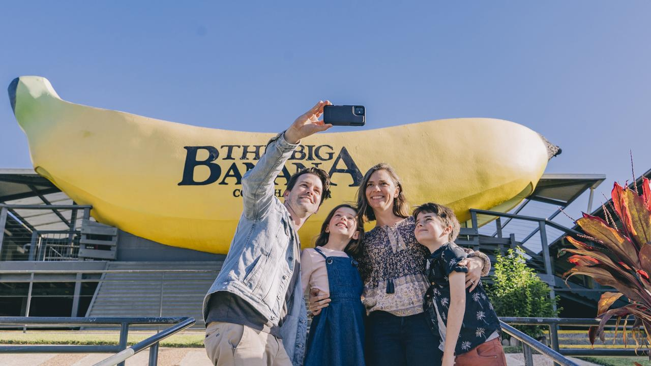 A family opt to take a selfie in front of the Big Banana, rather than the Big Prawn. Picture: Destination NSW