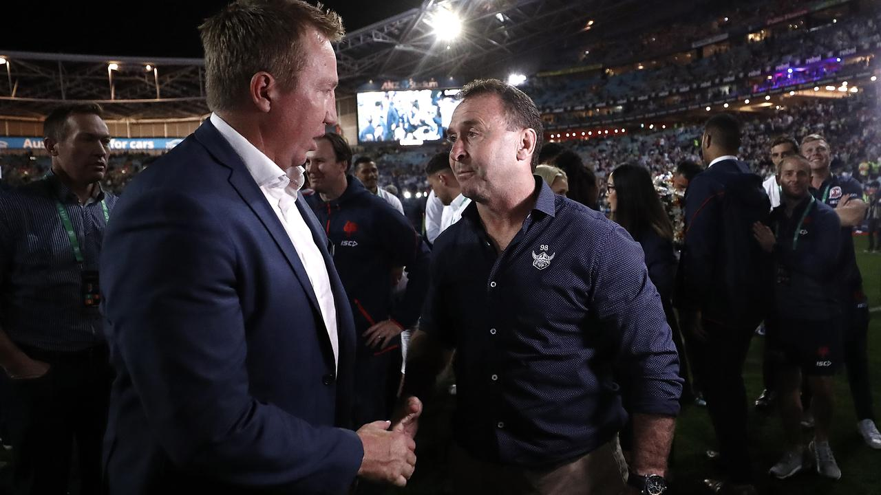 A rare handshake between the pair
