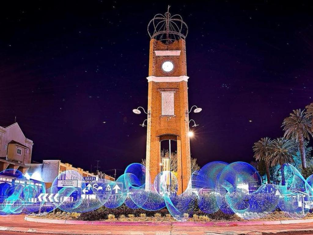 The crowned Grafton Clocktower during the 2018 Jacaranda Festival, submitted as a Photo of the Day to The Daily Examiner by Jess Littler.