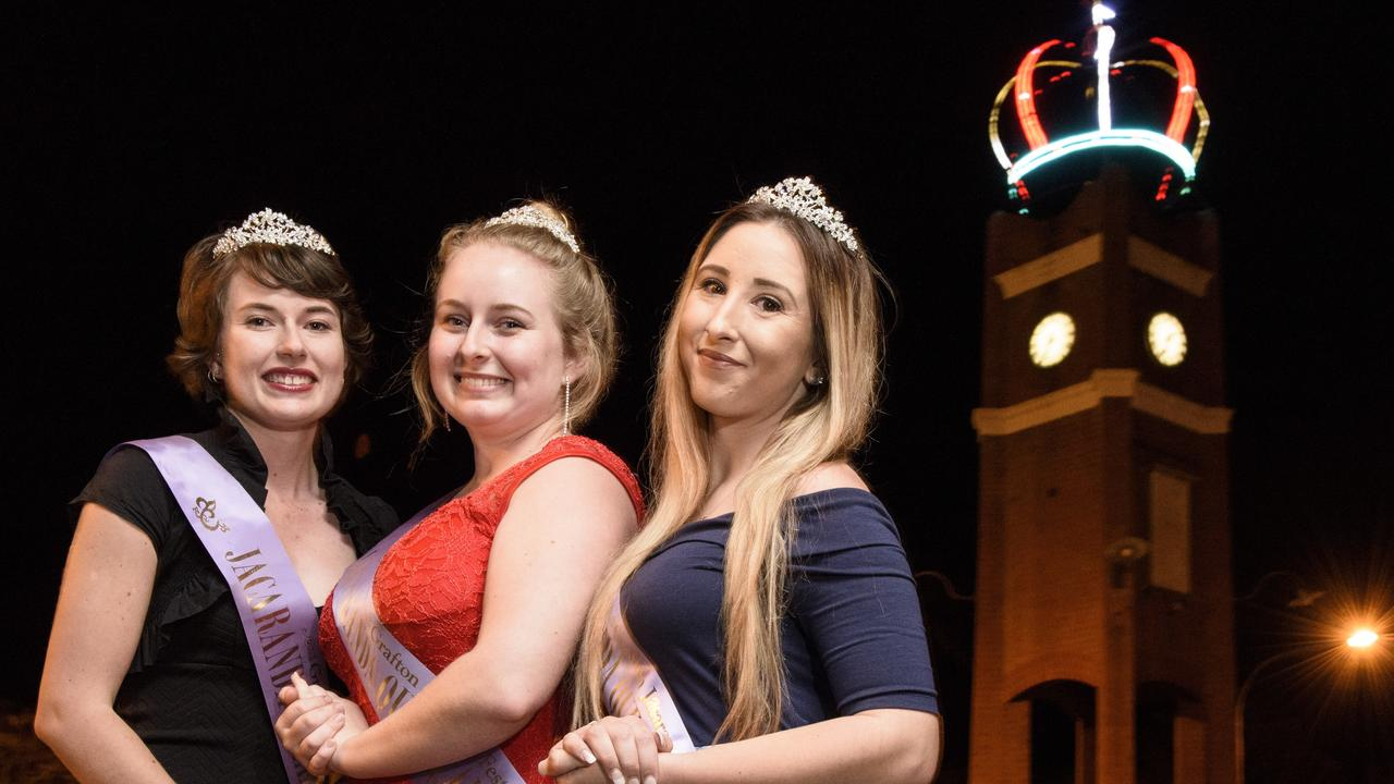 The 2016 Jacaranda Queen candidates in front of the lit up Jacaranda Crown on top of the clocktower in Prince St. While the crowning of this year's Queen's Party has been postponed, the clocktower will be crowned and lit up in all its glory to help keep the spirit alive this Jacaranda Season. Photo: Adam Hourigan / The Daily Examiner
