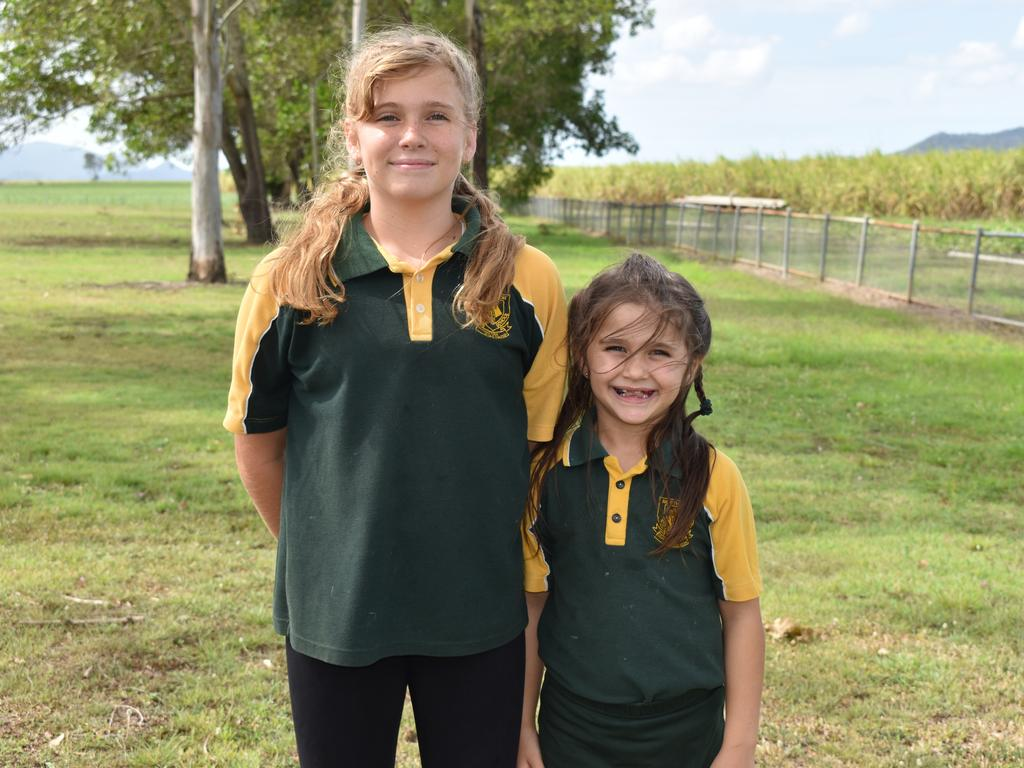 North Eton State School Year 5 student Jazmyn Hardy and Year 1 student Sofia Corsaro, whose mum and nunna also attended the school. Picture: Heidi Petith