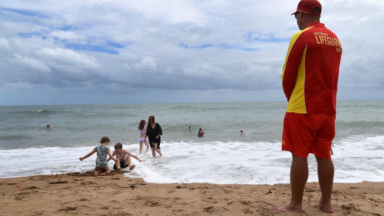 A lifeguard keeps an eye on bathers at Moore Park Beach. Photo: Mike Knott.
