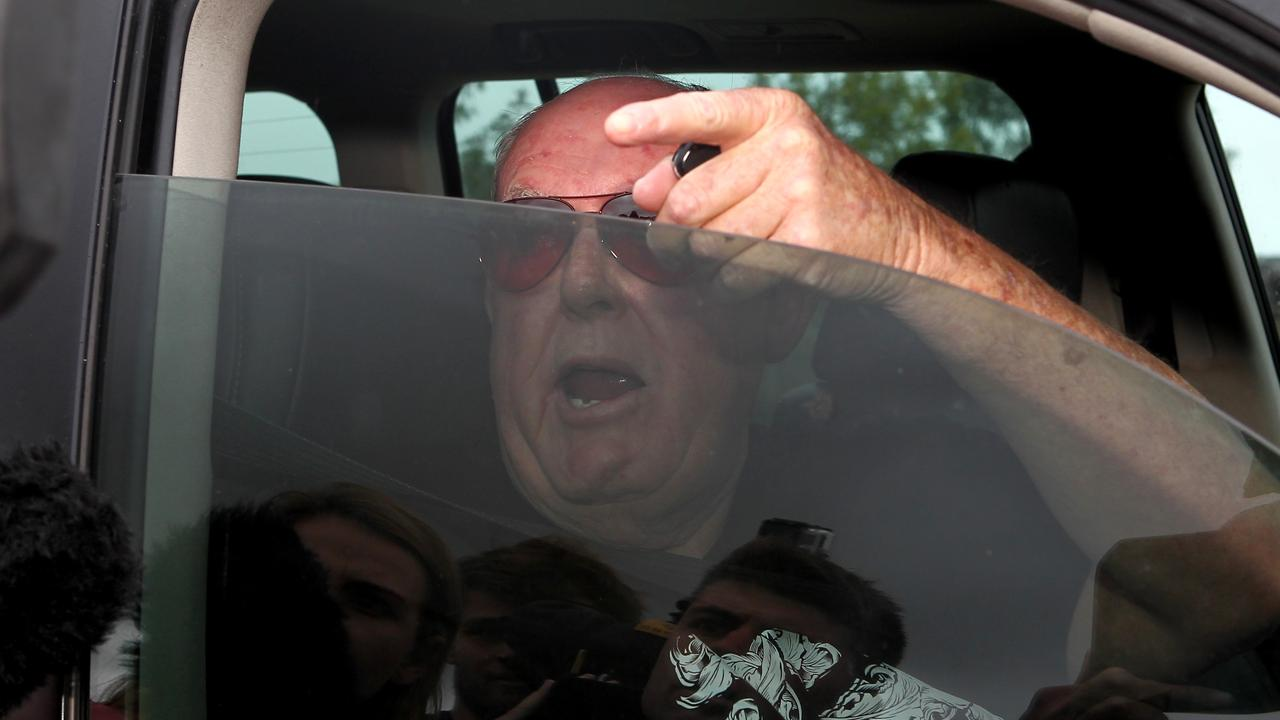 John Chardon arrives home after an overseas trip following his wife's disappearance. Picture: David Clark.