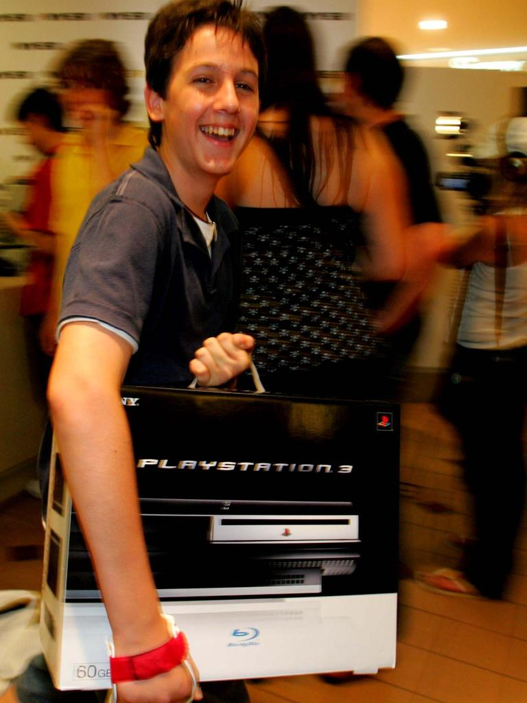 An excited young shopper picking up one of Australia's first PS3 consoles at the midnight launch at Myer back in 2007.