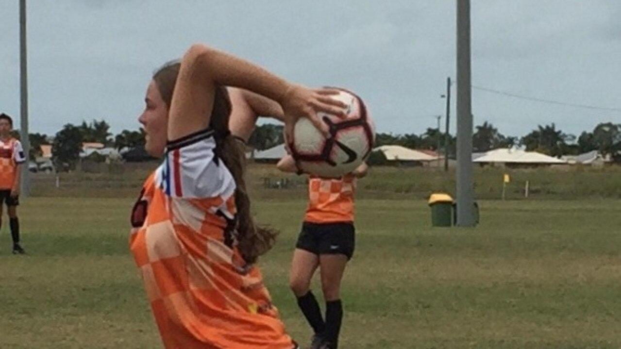 Defender Alice Wheeler restarting play from the side line. Photo: Lyndelle Swain