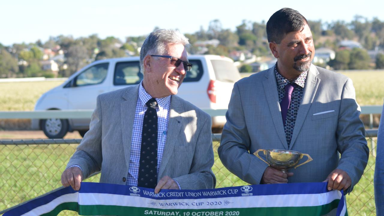 Owner Michael Kelly can't stop smiling as he stands with Warwick Turf Club president Phil Grant amid his 2020 Warwick Cup win.