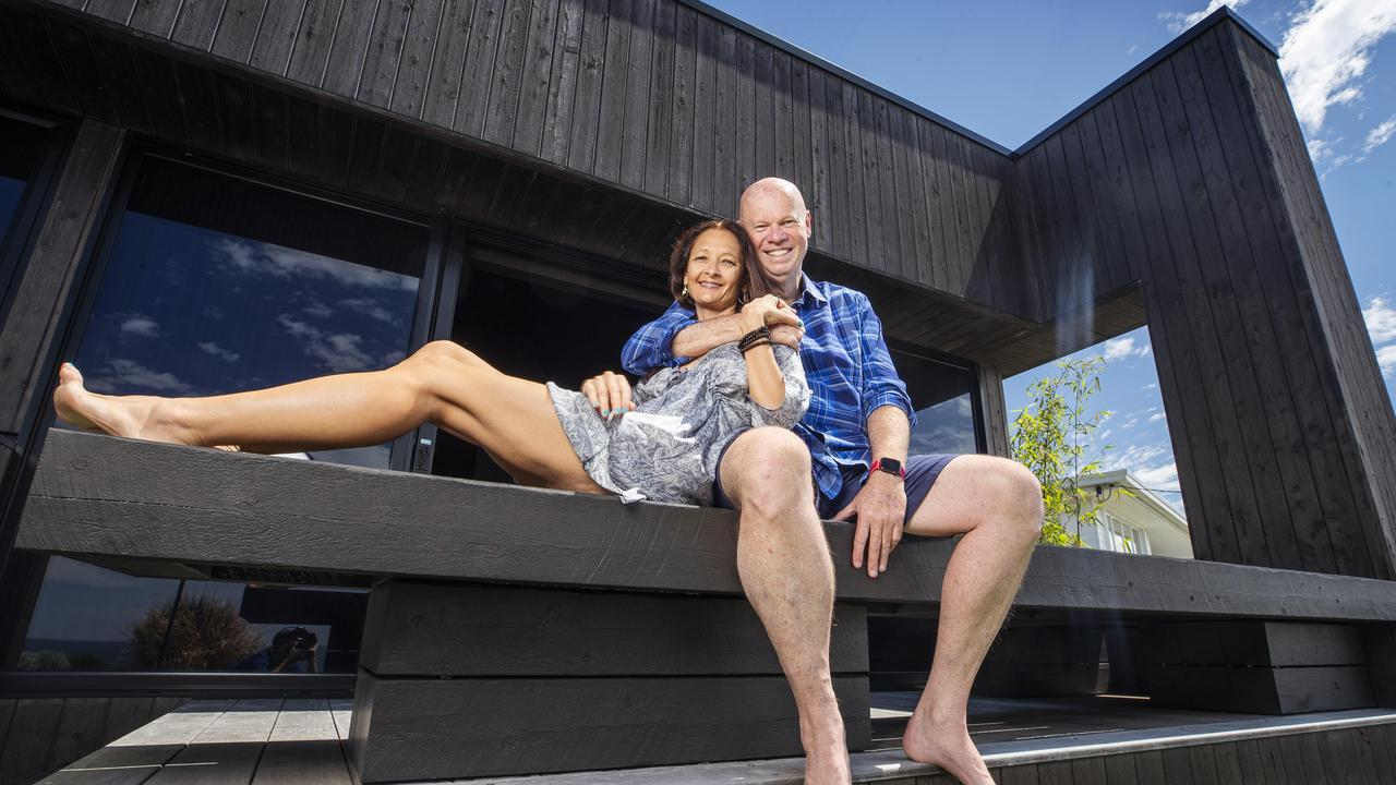Pete Stavroff with partner Rachael in their home at Orient Dr, Sunrise Beach — a Frank Macchia architect designed house inspired by Japanese architecture and techniques. Photo: Lachie Millard.