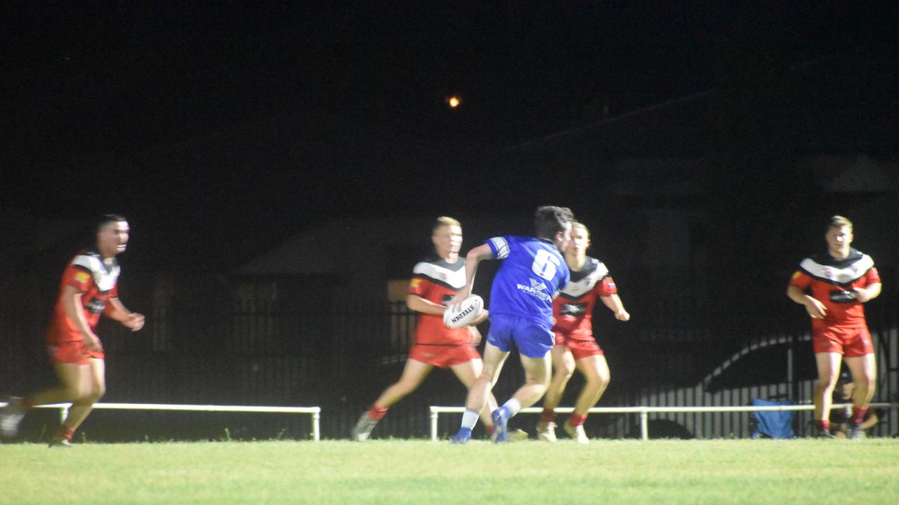 2020 GRAND FINAL: Wallaroos player Thomas Colvin passes the ball in front of the Panthers defence line. Photo: Stuart Fast