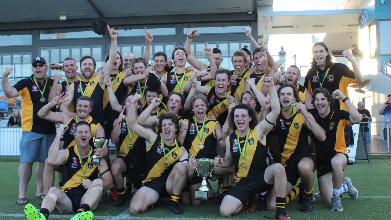 The Grafton Tigers celebrate after winning the 2020 AFL North Coast grand final against the Sawtell-Toormina Saints.