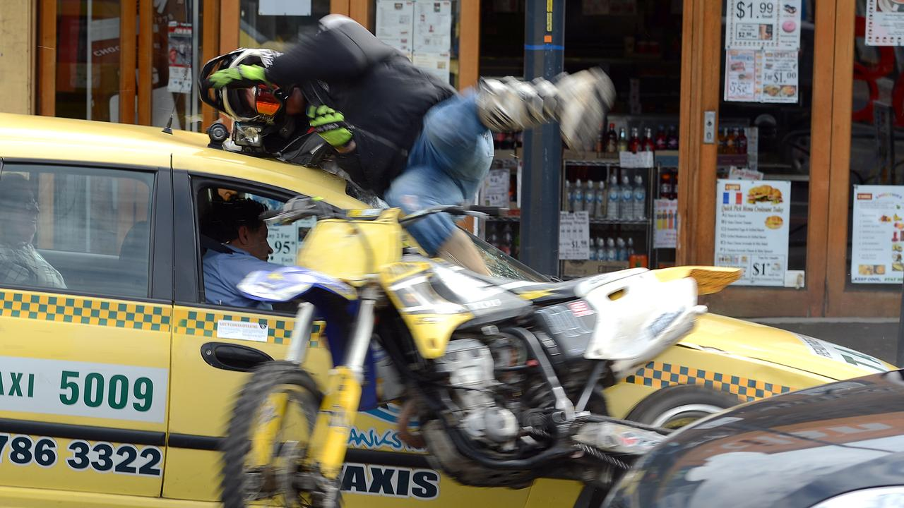 Sometimes photographers are just in the right place at the right time (or wrong time) to capture incredible images. That was the case with this amazing photo by Jason Sammon taken in 2013, of a man on a motorbike crashing into, and being flung over, a taxi on Station St Frankston, after attempting to avoid police wishing to pull him over. He later walked to an awaiting ambulance.