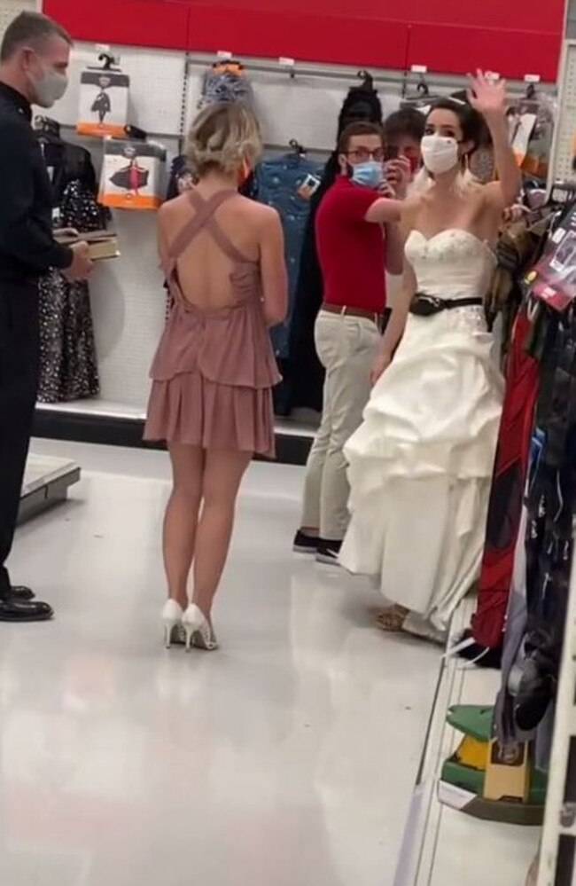 The bride, who is seen waving at those filming her, said she has been waiting for two years since he proposed, to marry him. Picture: TikTok/@boymom_ashley