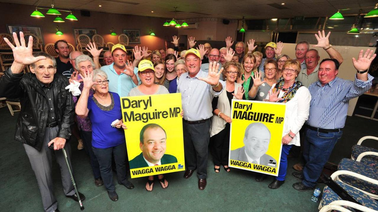 Daryl Maguire celebrates his win with supporters at his campaign office. Picture: Kieren L Tilly