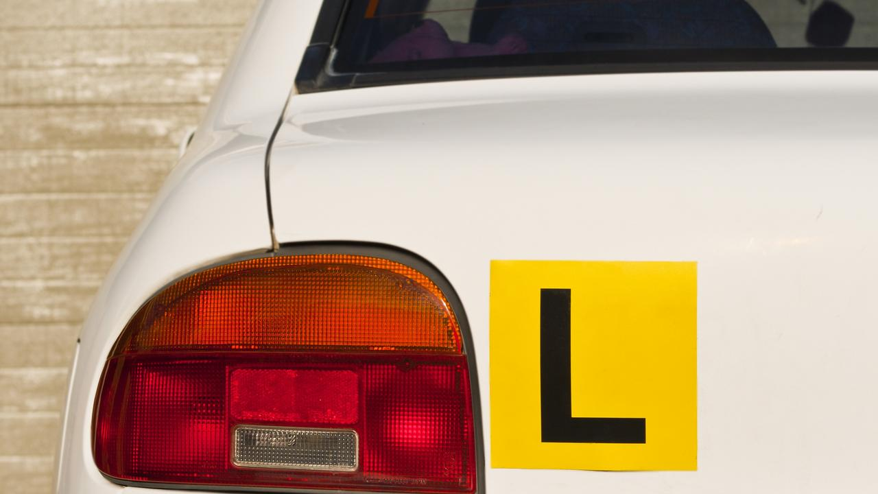 Image Of A Yellow L-Plate On White Car , Indicative Of A Learner Driver. Picture: iStock