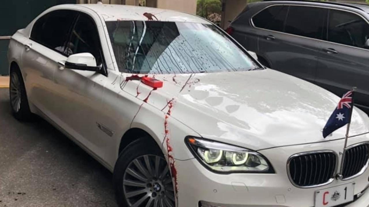 Protesters threw paint at Scott Morrison's car in a UQ protest. Picture: Supplied.