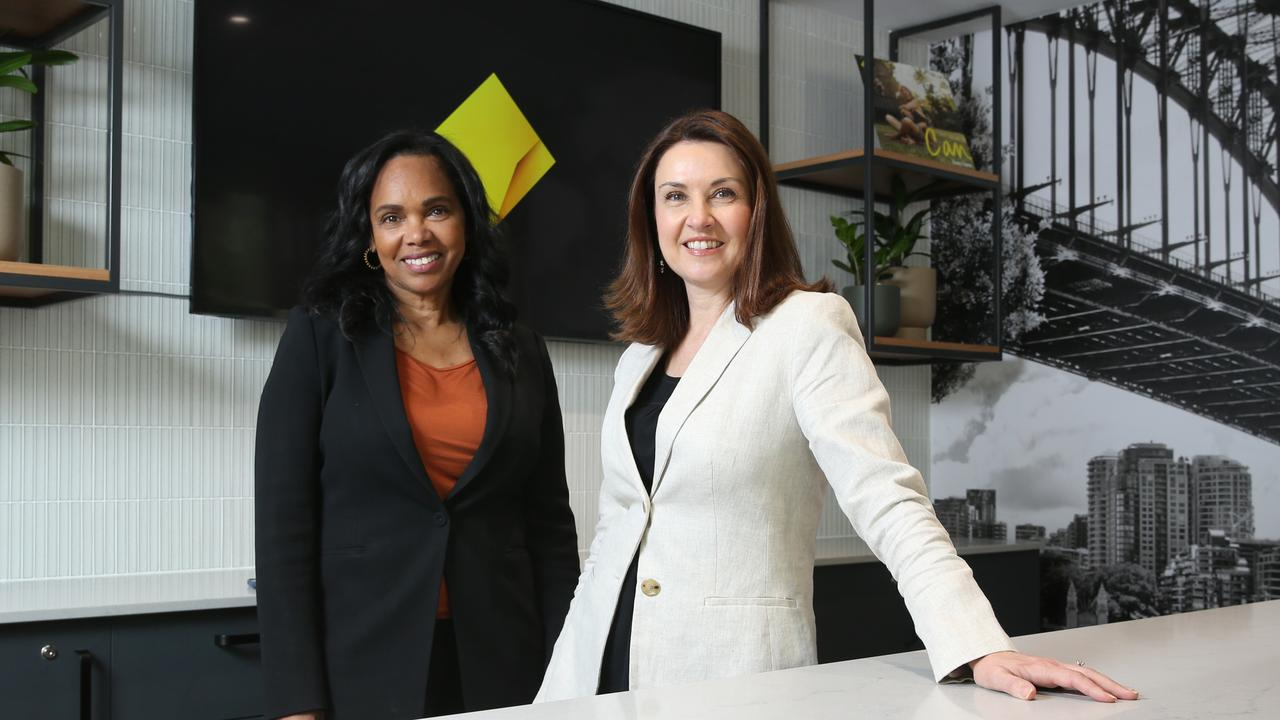 CBA Group executive marketing and corporate affairs Priscilla Brown and chief marketing officer Monique Macleod with the new CBA logo at their new branch on George St in Sydney's CBD. Picture: Britta Campion