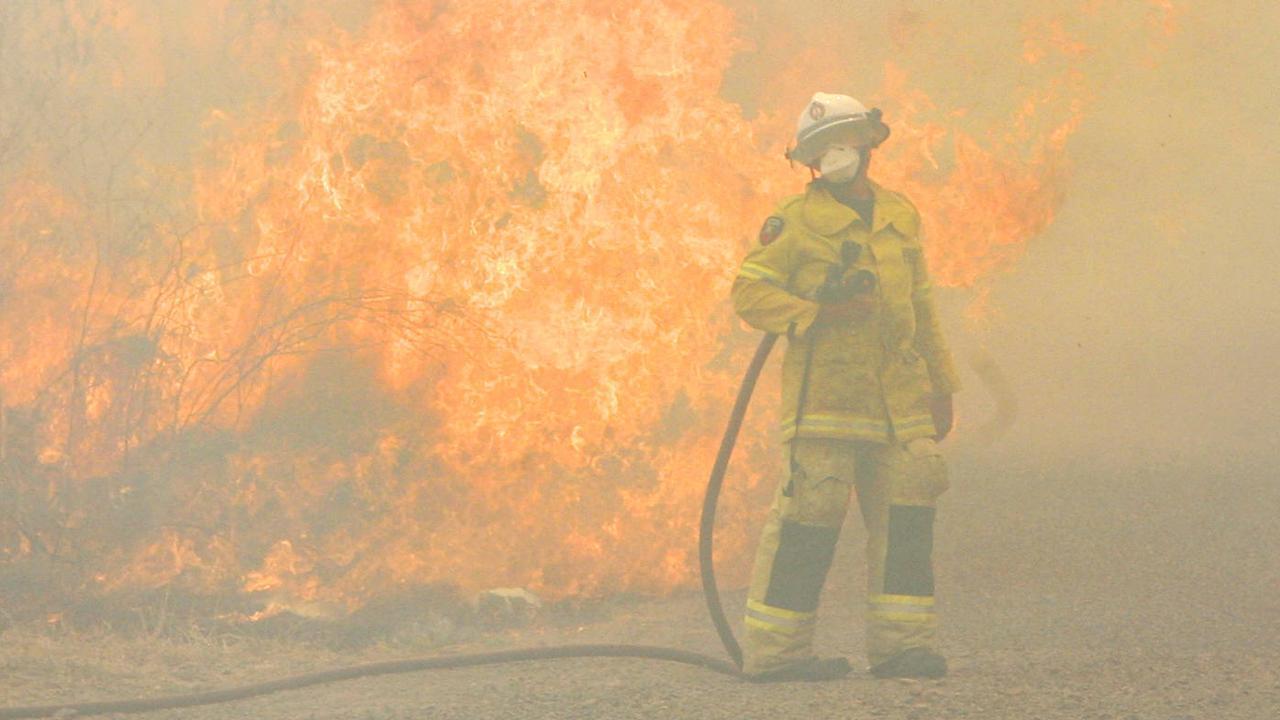 Fire fighters battle fires in Rockhampton during the recent bushfire season.