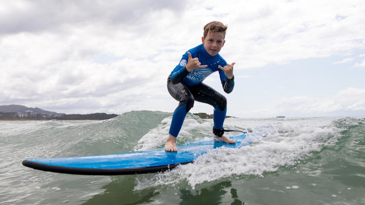 Surf Grom Rory riding a wave in Coffs Harbour. Photo: Blainey Woodham / Surfing Australia