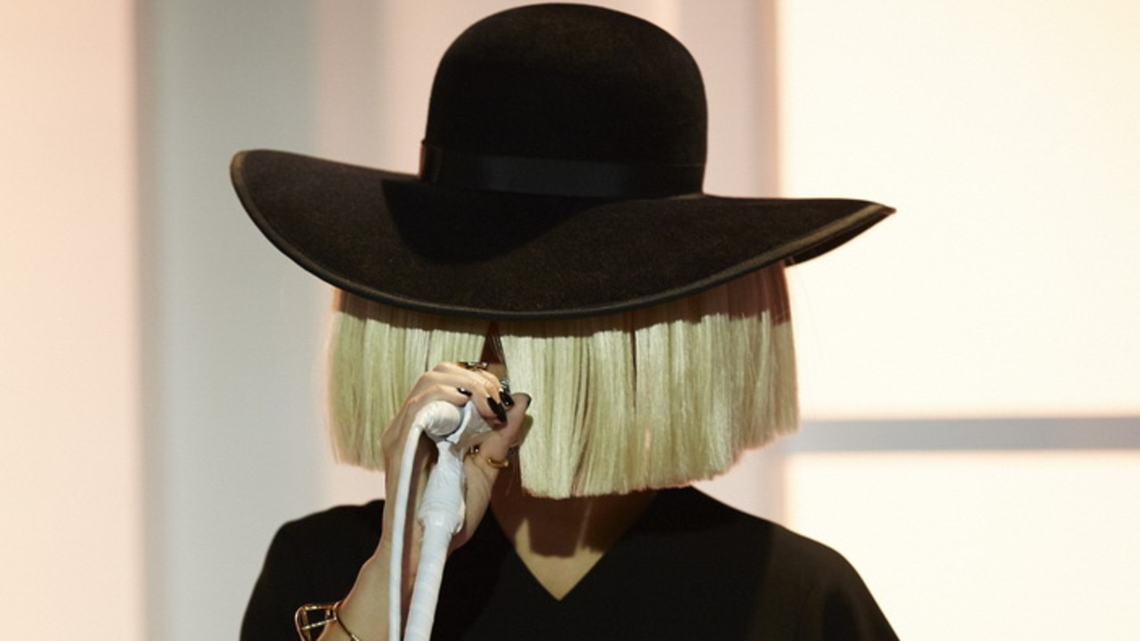 Sia has been known for her use of extravagant wigs to hide her identity on the stage.