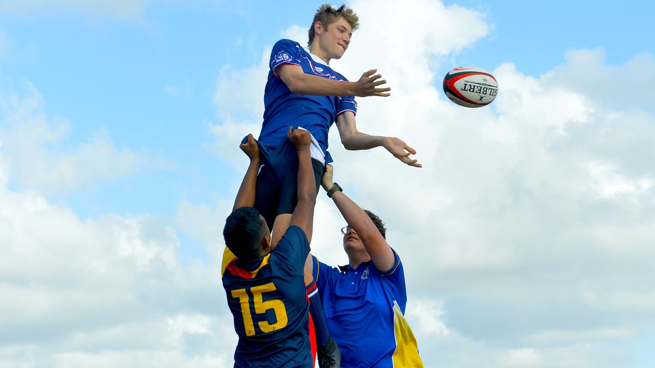 Mackay Christian College student Tom Dean flies high for a lineout at Quarry Hill. Photo: Callum Dick