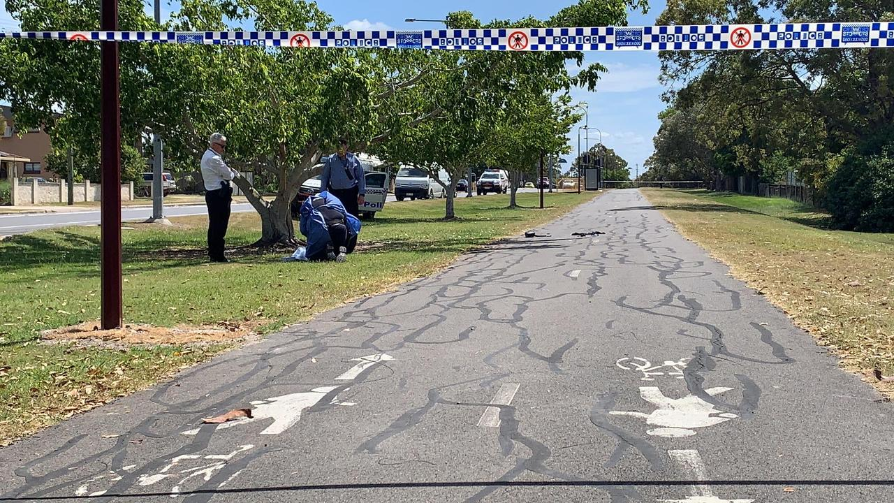 Police guard the scene of an alleged stabbing.