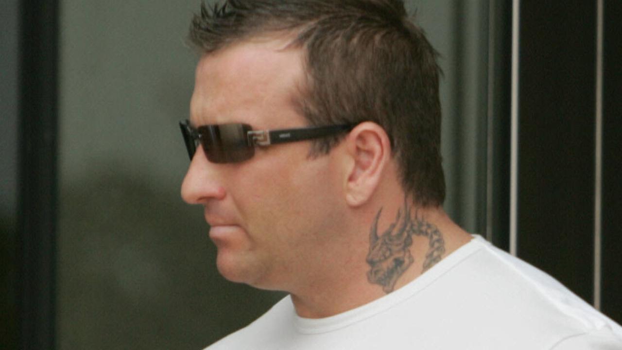 Bikie Shane Bowden walks into Southport Courthouse.
