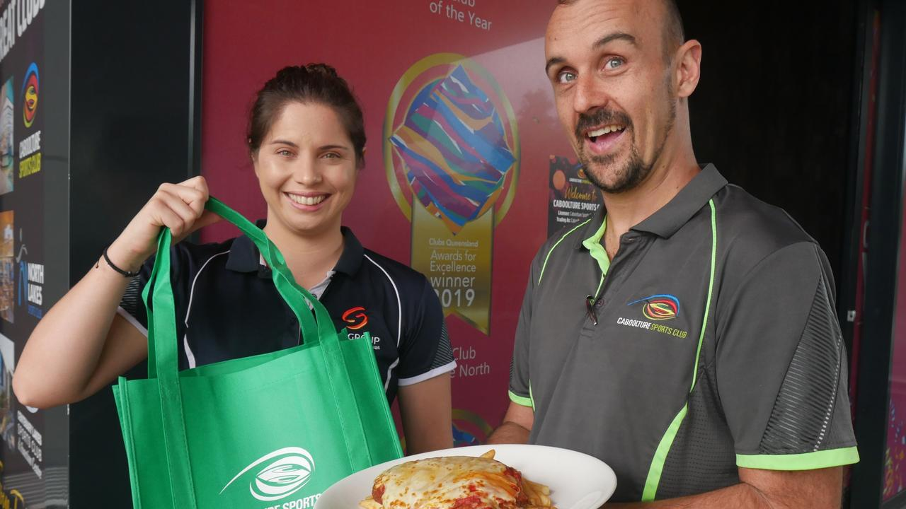 Caboolture Sports Club Venue & Culture Manager Suzy Vercoe and Executive Chef Anthony Gavin with a chicken parmy which was part of the club's takeway menu introduced during COVID-19.