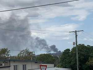 Tyre fire spreads black smoke over highway