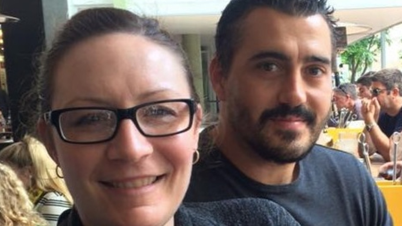 Nicole Marchment and Darren Budini are stuck at Qld/NSW border where they are waiting in limbo until Queensland Health either denies or approves a request for Mr Budini to attend his mother's funeral.