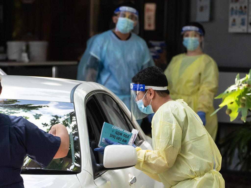 Healthcare workers administering COVID-19 tests at a drive-through testing centre in Leichhardt. Picture: NCA NewsWire / James Gourley