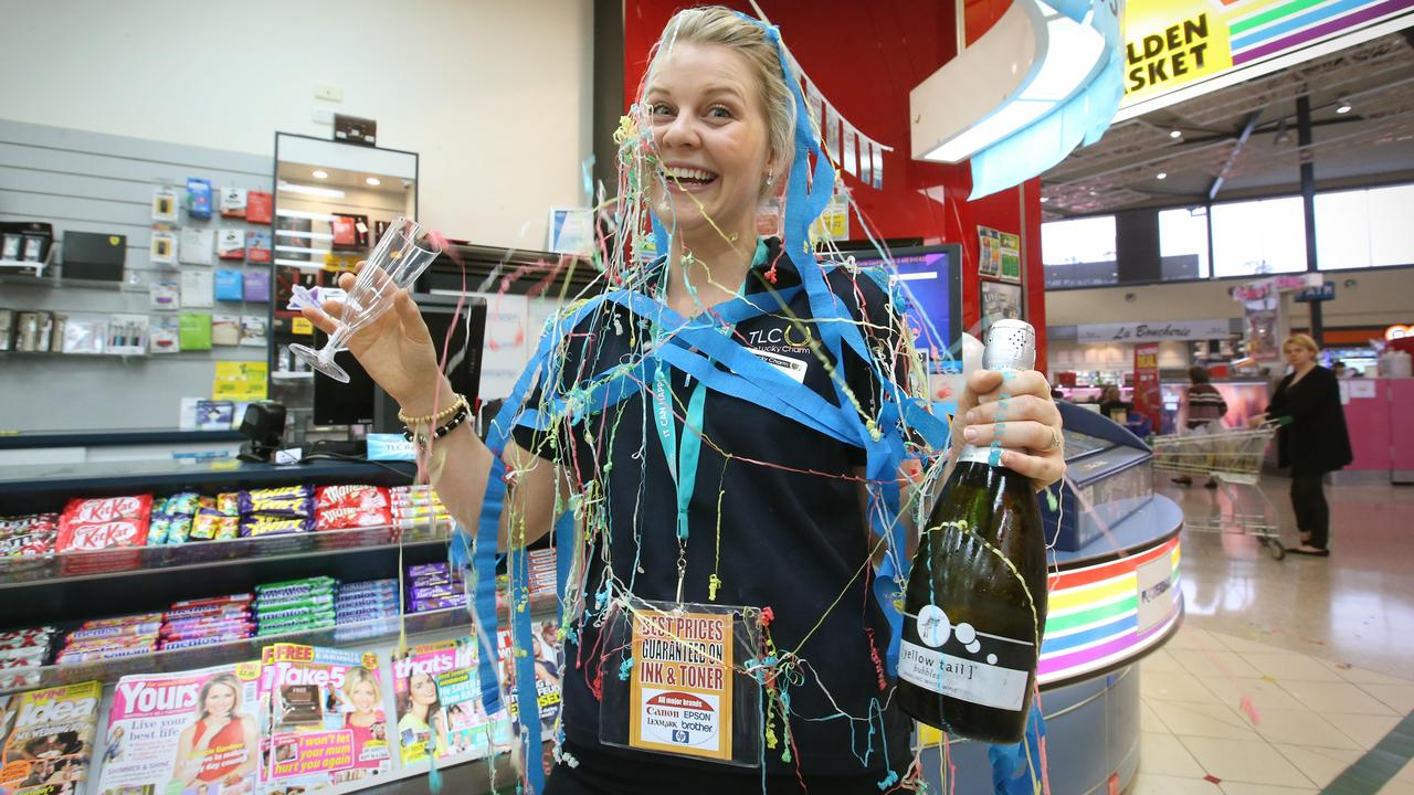 Kerrie O'Brien checked the winning Powerball ticket for the lady who won the $35 Million at the Lucky Charm Newsagents at the Noosa Civic shopping centre. Picture: Jamie Hanson