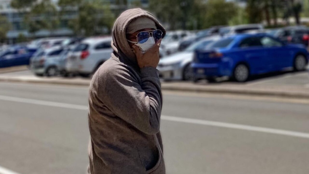 Taxi driver Waheedullah Jalal covered his face walking from Maroochydore District Court after he was sentenced for sexual assault.