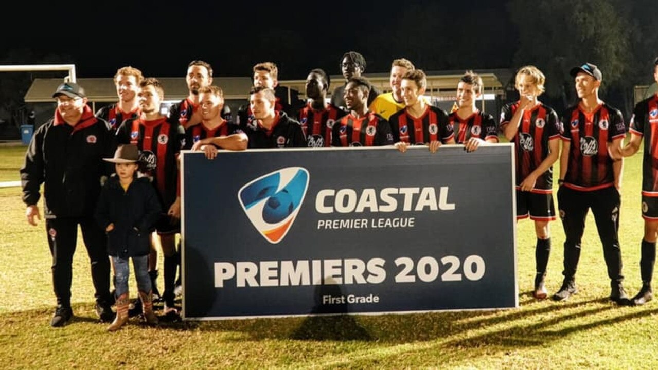 The Coffs City United Lions are presented with the inaugural Coastal Premier League trophy after finishing top of the table. Photo: Coastal Premier League