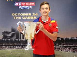 Callum fufills dream to hold AFL Premiership Cup