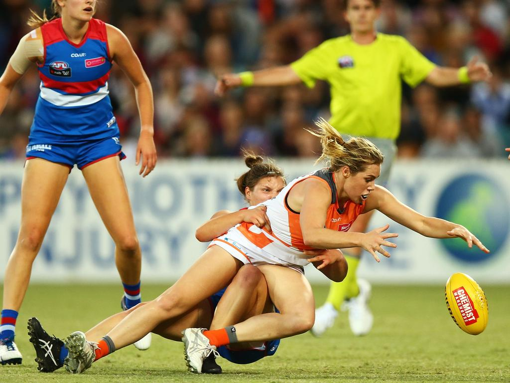 Jacinda Barclay tackled during her debut AFLW season in 2017.