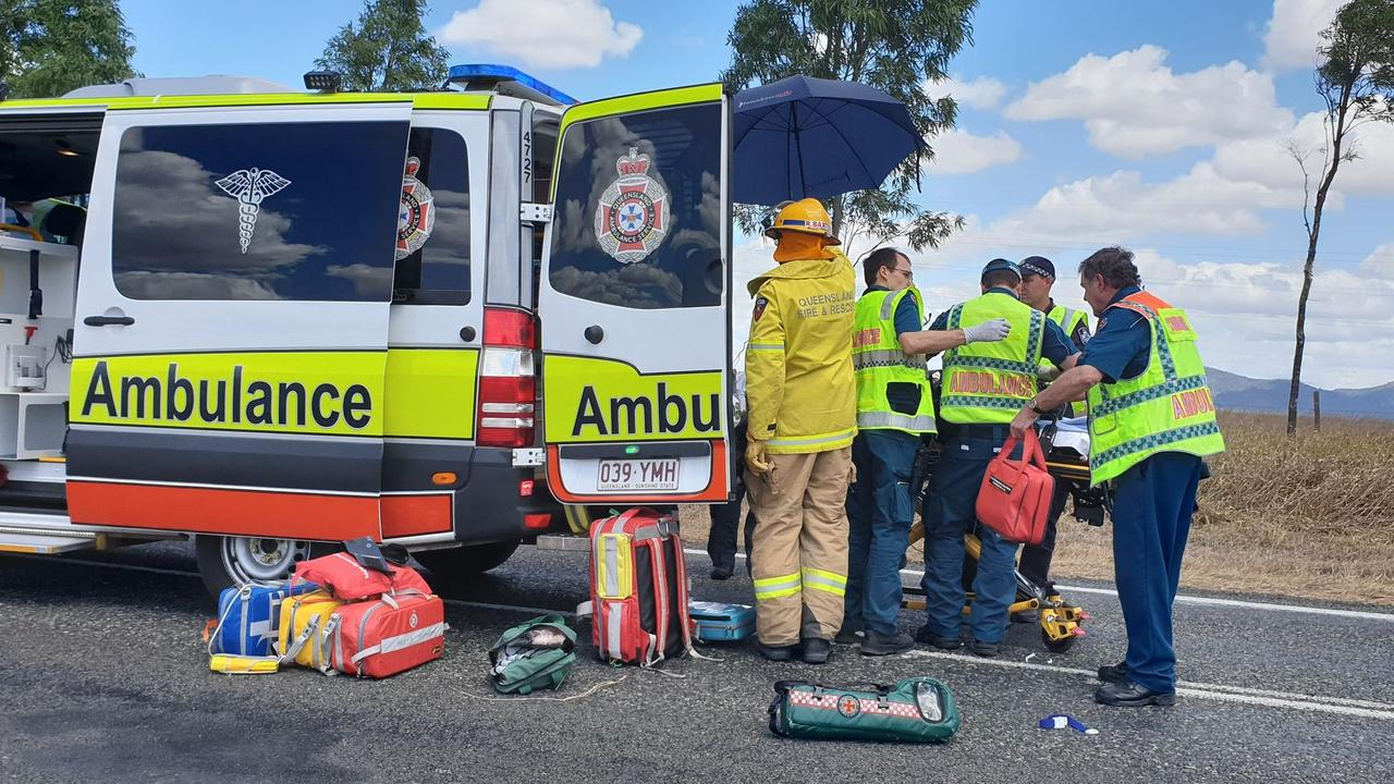 Paramedics try to stabilise one of the crash victims while rescue helicopters wait to transport them. Picture: Frances Klein