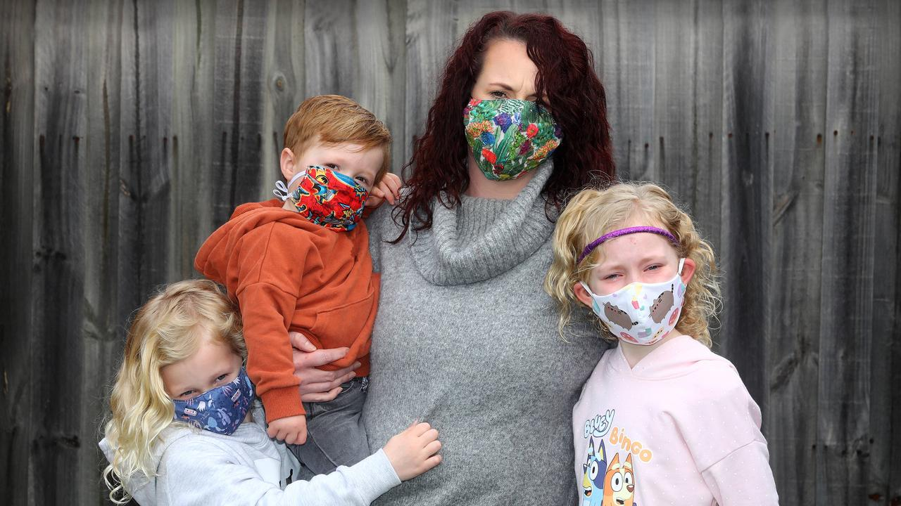 Young mum Tara, with her three kids, has had coronavirus and continues to battle ongoing effects. Picture: Glenn Ferguson