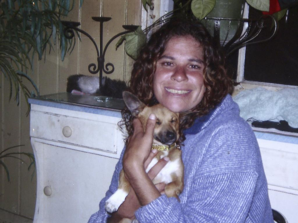 Lynette Daley, pictured cuddling her dog Bunyip, died on a secluded beach after enduring catastrophic injuries after she was sexually assaulted. Two men convicted over her rape and death have launched an appeal.