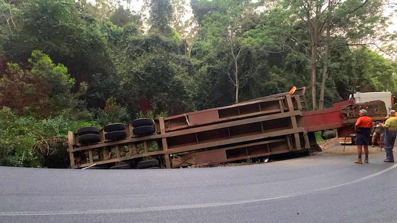 A truck carrying a bulldozer has overturned on Eastern DOrrigo Way near Coramba. Photo: Frank Redward